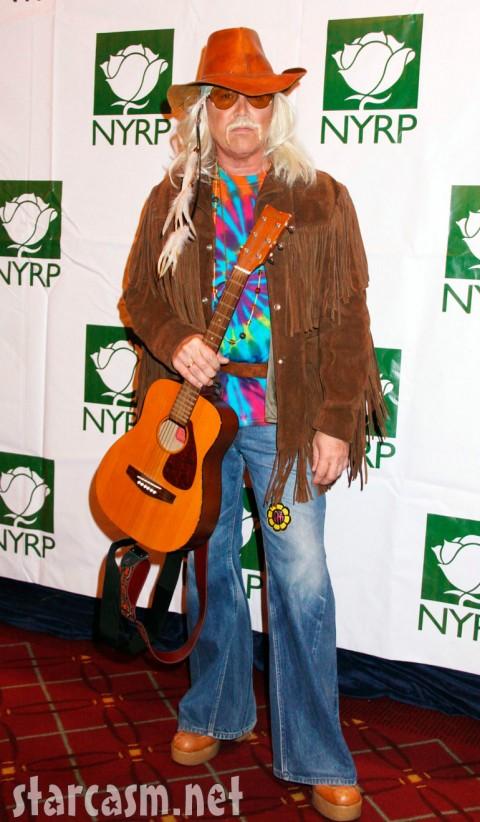 Michael Kors in a tie-dyed guitar-toting beatnik costume