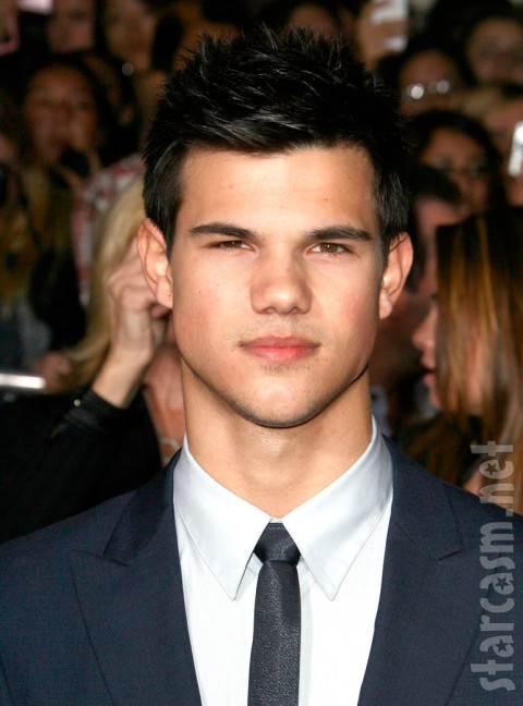 A stoic Taylor Lautner on the red carpet at the New Moon Premiere