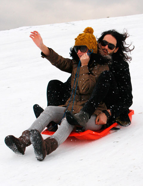 Katy Perry and Russell Brand go sledding