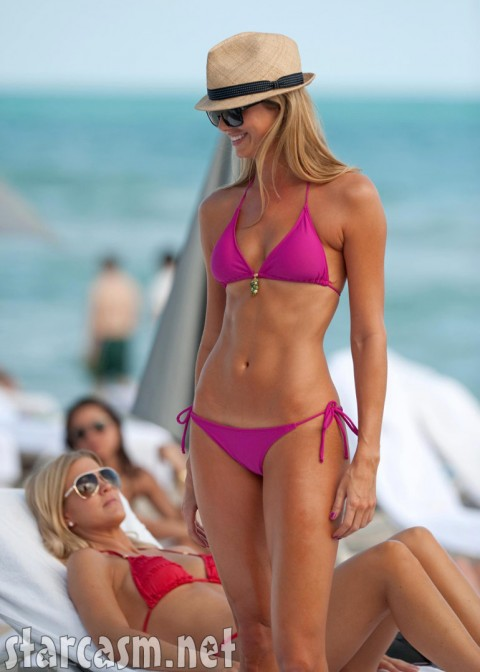 Stacy Keibler's hot bod is barely contained by a picayune hot pink bikini