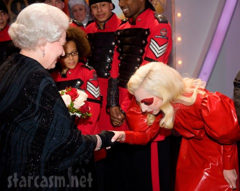 Lady Gaga in red latex bowing in front of Queen Elizabeth II