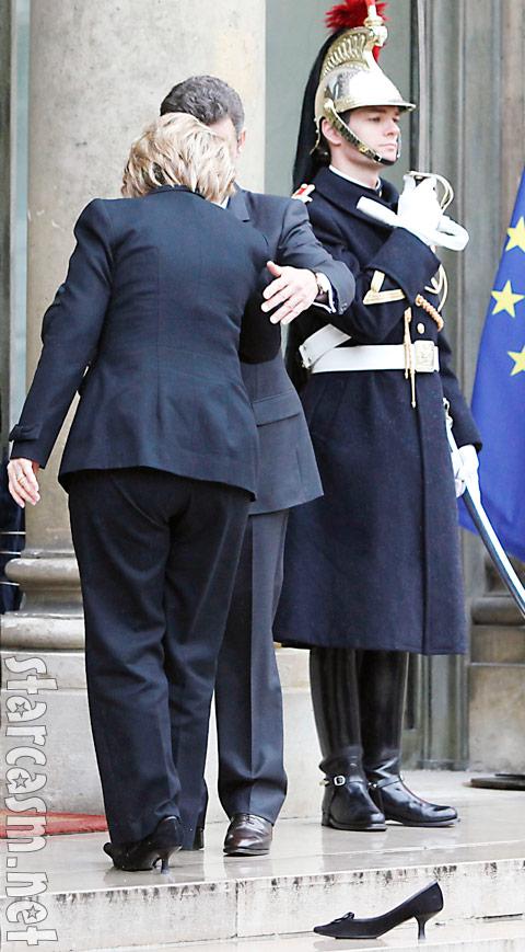 Hillary Clinton hugs Nicolas Sarkozy with one shoe on