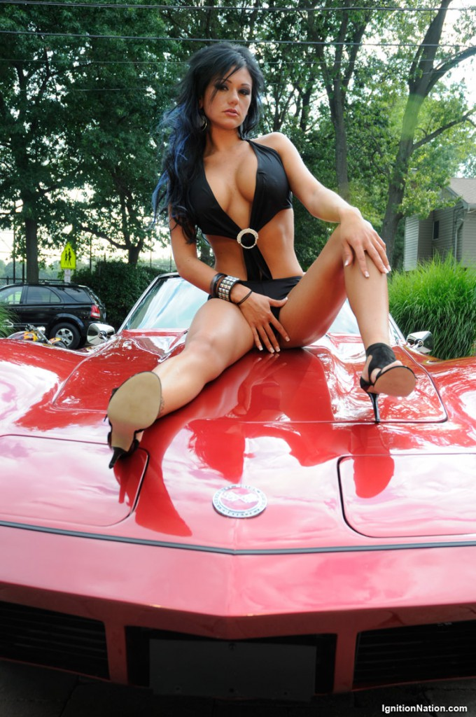 Jersey Shore's Jenni J-Woww Farley wears a swimsuit and high heels on the hood of a corvette