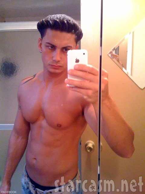 Pauly D snaps a cell phone photo of himself and his blowout hairstyle