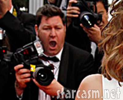 A photographer admires Cheryl Cole at the premiere of Outside the Law in Cannes 2010
