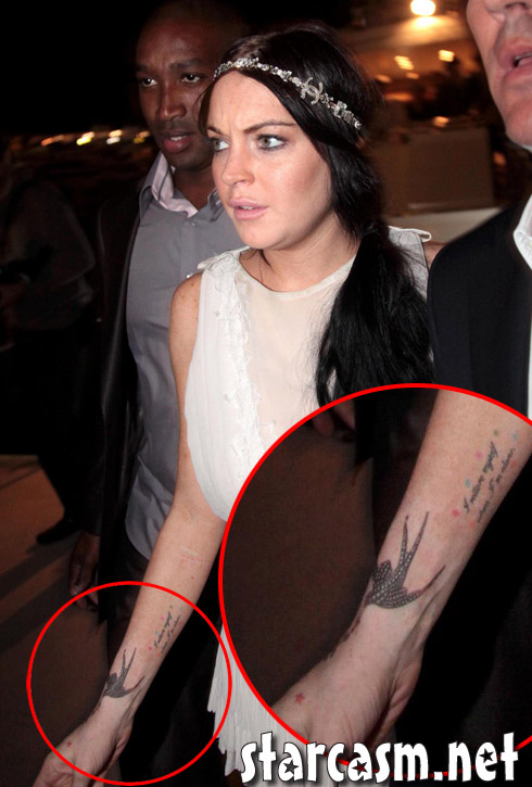 Lindsay Lohan's new tattoo in Cannes looks like a swallow and a Chanel logo