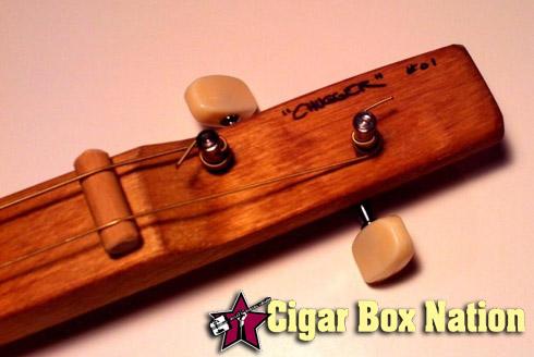 2-string cigar box guitar headstock