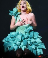 Lady Gaga wears a dress made of over-sized turquoise crystals