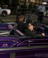 Michelle Rodriguez and her purple ride