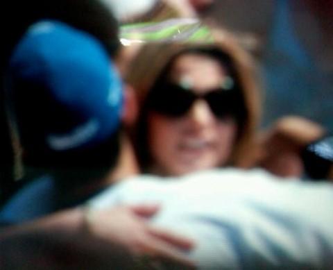 Joe Jonas and Ashley Greene hugging at a baseball game