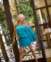 Alexis Bellino models a blue dress for her new fashion line Alexis Couture Picture 1