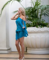 Alexis Bellino models a blue dress for her new fashion line Alexis Couture Picture 3