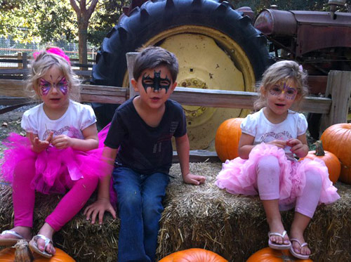 Jim and Alexis Bellino's children have fun at the pumpkin patch