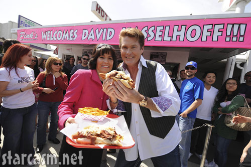 David Hasselhoff holds up a hot dog at Pink's hot dogs in California