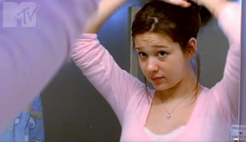 Emily McKenzie Peterson looks at herself in the mirror in 16 and Pregnant