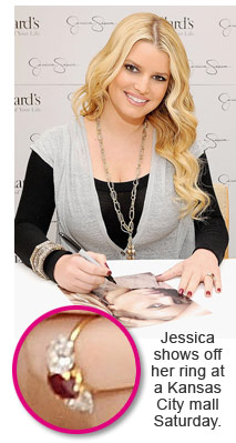 Jessica Simpson shows off her engagement ring at a Dillard's promotional event in Kansas City