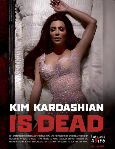 """Poster ad for Keep A Child Alive stating """"Kim Kardashian Is Dead"""" with her in a coffin"""