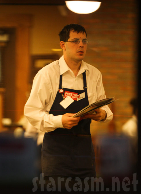 Clinton Yunker waiting tables at a restaurant in Anderson Indiana