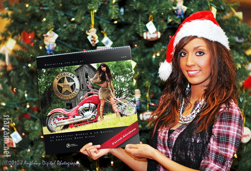 Teen Mom Farrah Alexander holds her Mastering the Art of American Motorcycles calendar