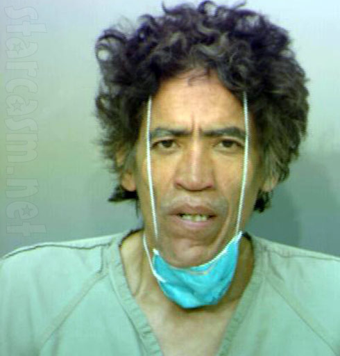 The man with the golden voice Ted Williams mug shot with a surgical mask