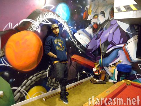PHOTOS Chris Brown paints graffiti self portrait in West