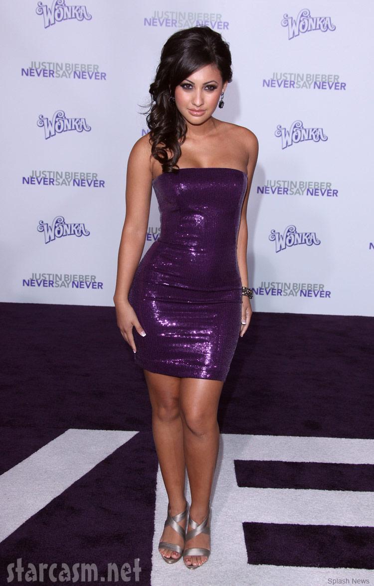 Francia Raisa looking sexy in a skin-tight purple dress