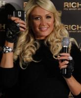 Paris Hilton wears Chanel glove