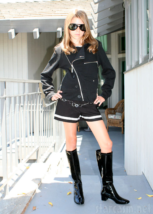 Alana Lee styles in black sunglasses and vinyl boots!