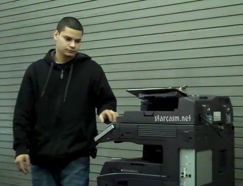 Jonathan Rivera working on a copier