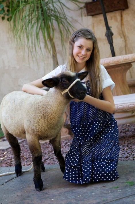 "Alana Lee with the mascot sheep of ""The Measure of a Man"""