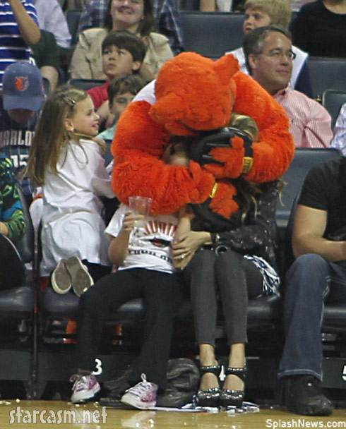 Emily Maynard and her daughter Ricki get Lynx hugged by Rufus the Charlotte Bobcat mascot