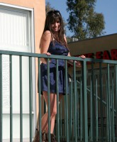 Friday Singer Rebecca Black poses for pictures at her billboard unveiling (10 of 16)