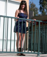 Friday Singer Rebecca Black poses for pictures at her billboard unveiling (13 of 16)