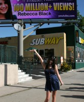 Friday Singer Rebecca Black poses for pictures at her billboard unveiling (9 of 16)