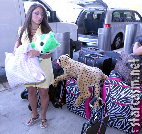 Deena Nicole Cortese of Jersey Shore carries a stuffed animal to the Newark airport