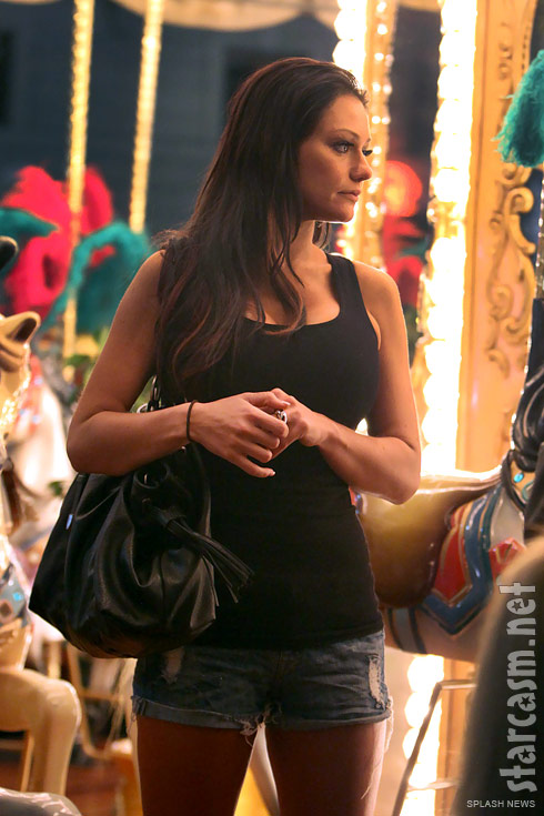 Jersey Shore's JWoww poses in front of a carousel in Florence, Italy
