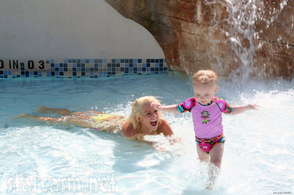Teen Mom Leah Messer plays with daughter Aleeah in a pool in Orlando