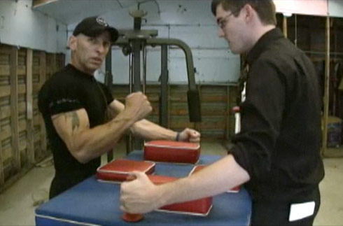 Swamp People's R.J. Molinere demonstrating how to arm wrestle