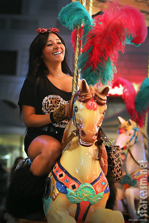 Snooki from Jersey Shore rides a carousel in Florence Italy