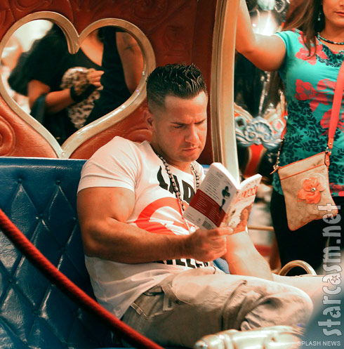 The Situation reads a How To Speak Italian book while riding a carousel in Florence Italy