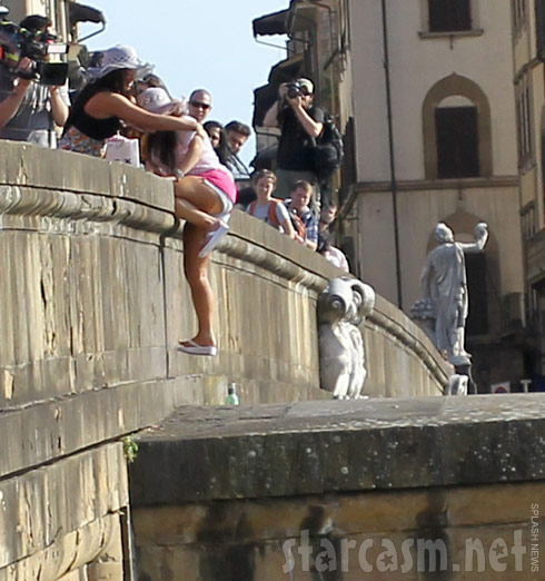 Jersey Shore's Deena Nicole Cortese hangs from a bridge in Florence, Italy