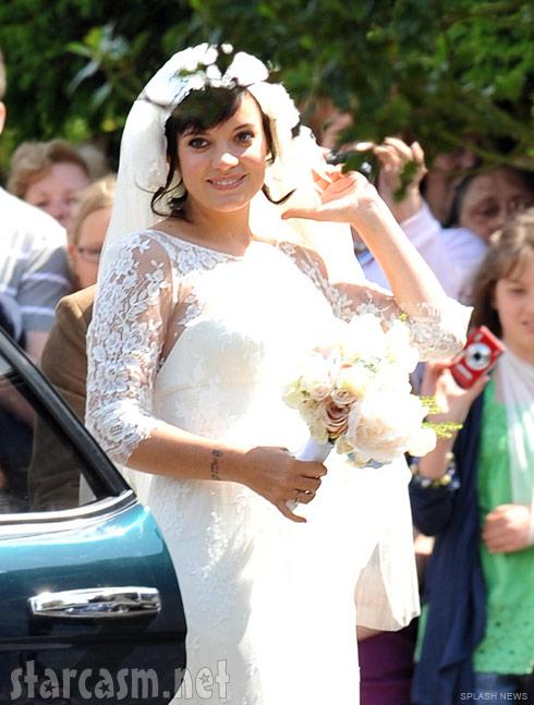 Lily Allen smiles radiantly at her wedding in the village of Cranham