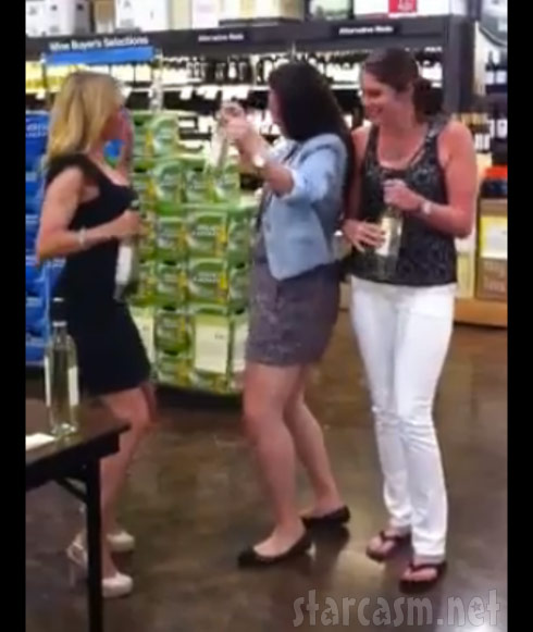 Ramona Singer does the Turtle Time dance with fans at a wine signing
