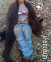 Krystal Campell American hoggers with a bear