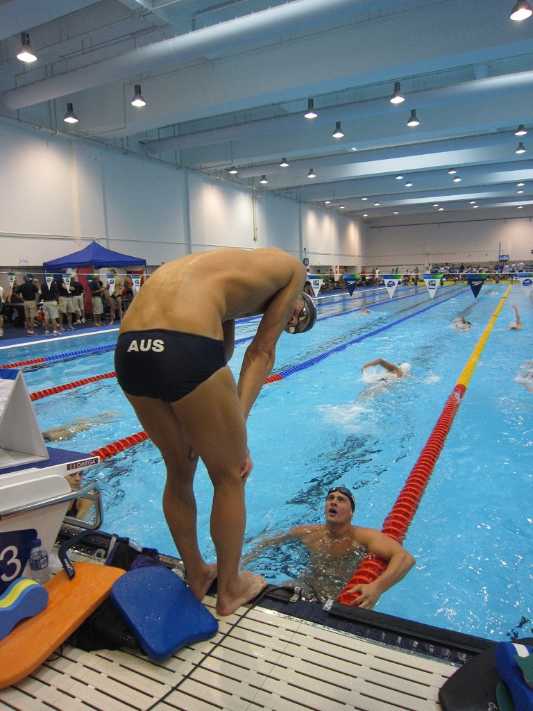 Swimmer Michael Phelps in a pair of Australian team swimming trunks with AUS