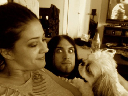 Weston Cage in bed with his wife Nikki Williams and their dog M-it