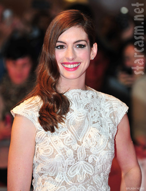 Anne Hathaway in a white lace dress