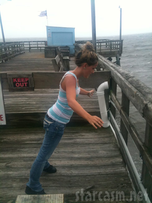 Jenelle Evans on a pier in Oak Island during hurricane Irene