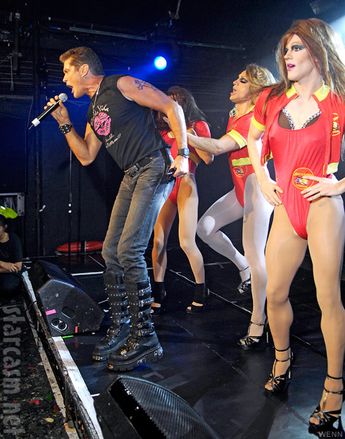 David Hasselhoff with three Baywatch swimsuit clad drag queens at club G-A-Y in London