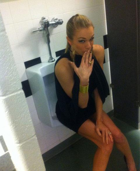 LeAnnRimes sits on a man's urinal